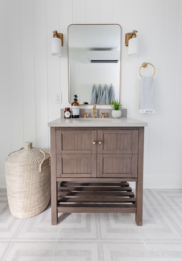wood vanity grey pattern tile floor white paneled walls