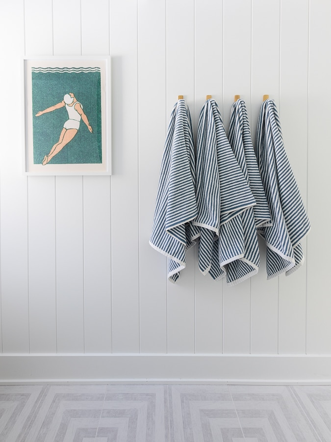 blue and white striped towels vintage swimming art coastal bathroom