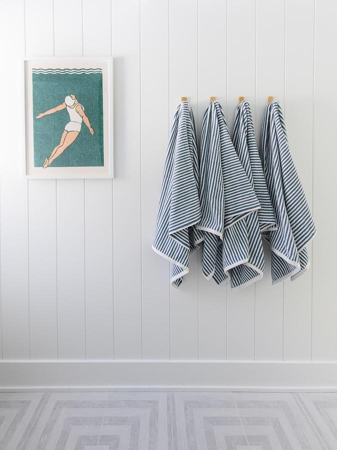 blue and white striped towels vintage swimming art coastal bathroom