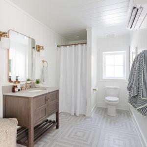 gray patterned floor, white paneled walls bathroom