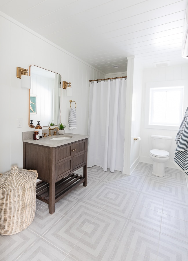 bathroom gray patterned tile white walls