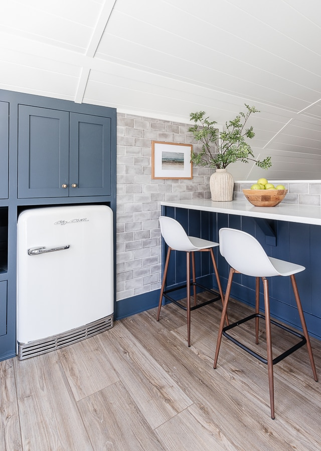 navy cabinets, gray tile, retro big chill appliances