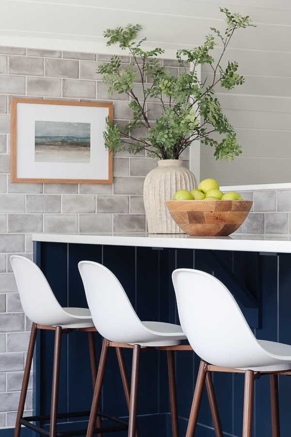 white plastic chairs navy cabinets snack bar