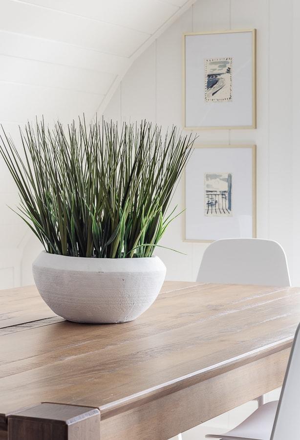 white paneled walls, wood floors dining area