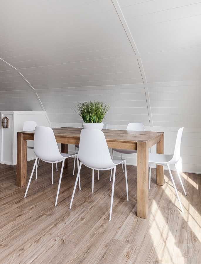 wood LVP floors, wood dining table white chairs