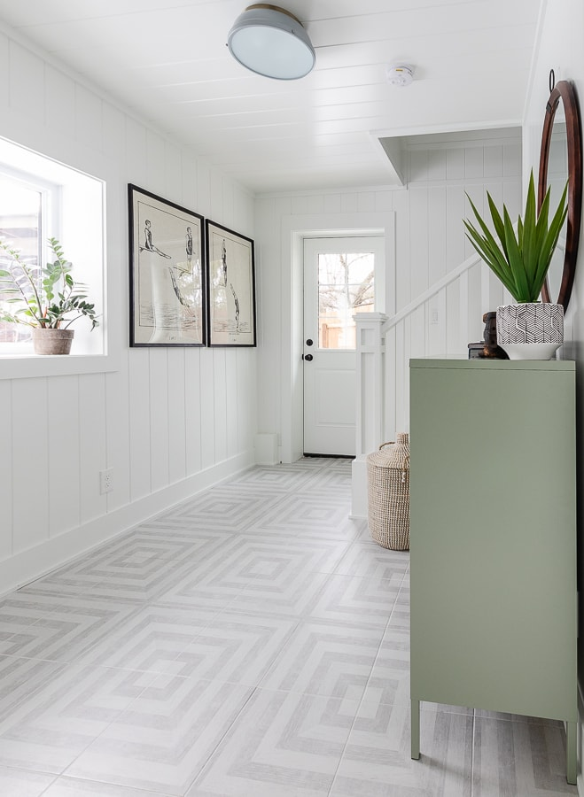 white walls gray patterned tile flooring pool house