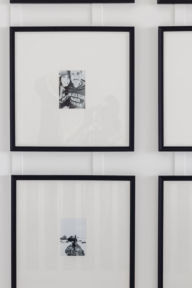 Black and white staircase gallery wall