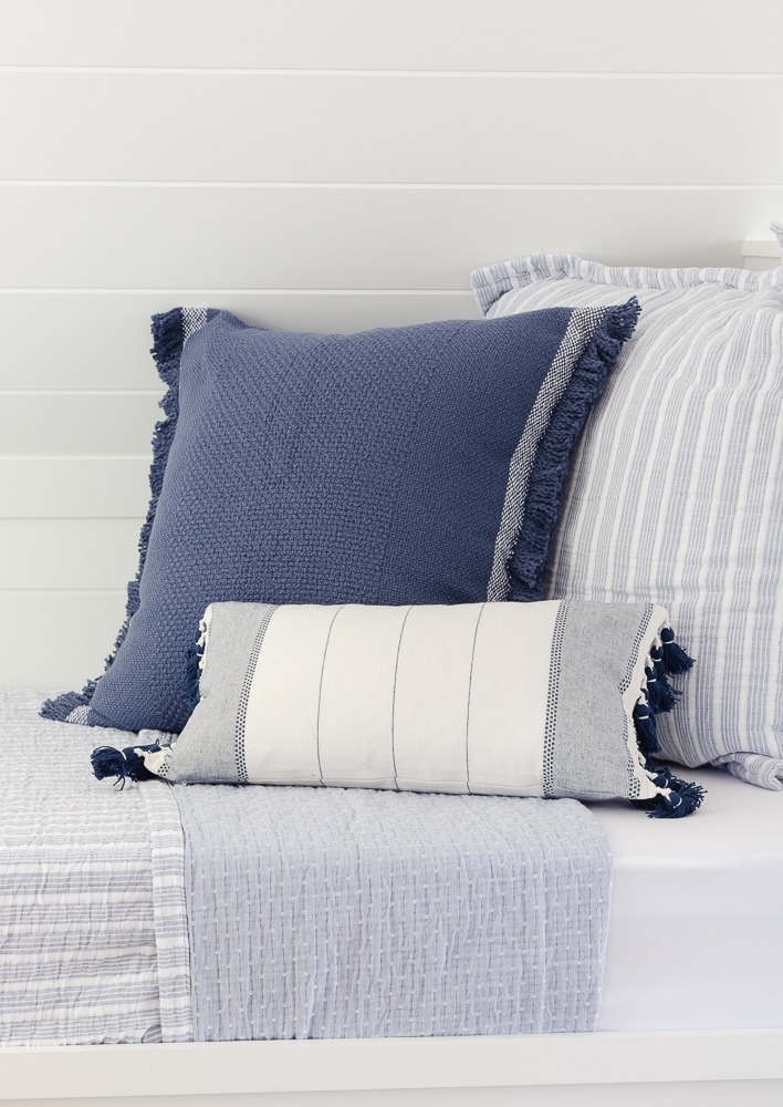blue and white throw pillows and bedding