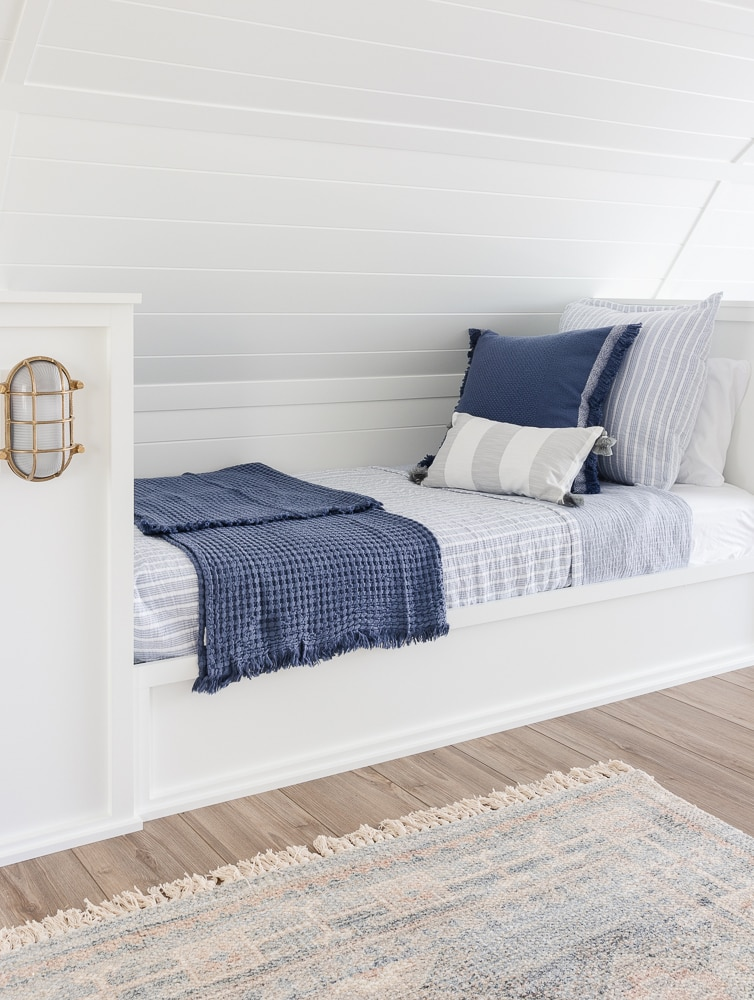 white built in beds with blue and white bedding
