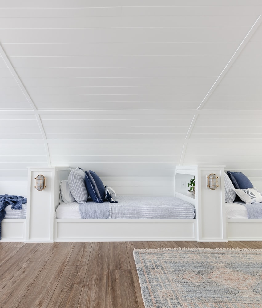 built in bunk room beds with blue and white bedding