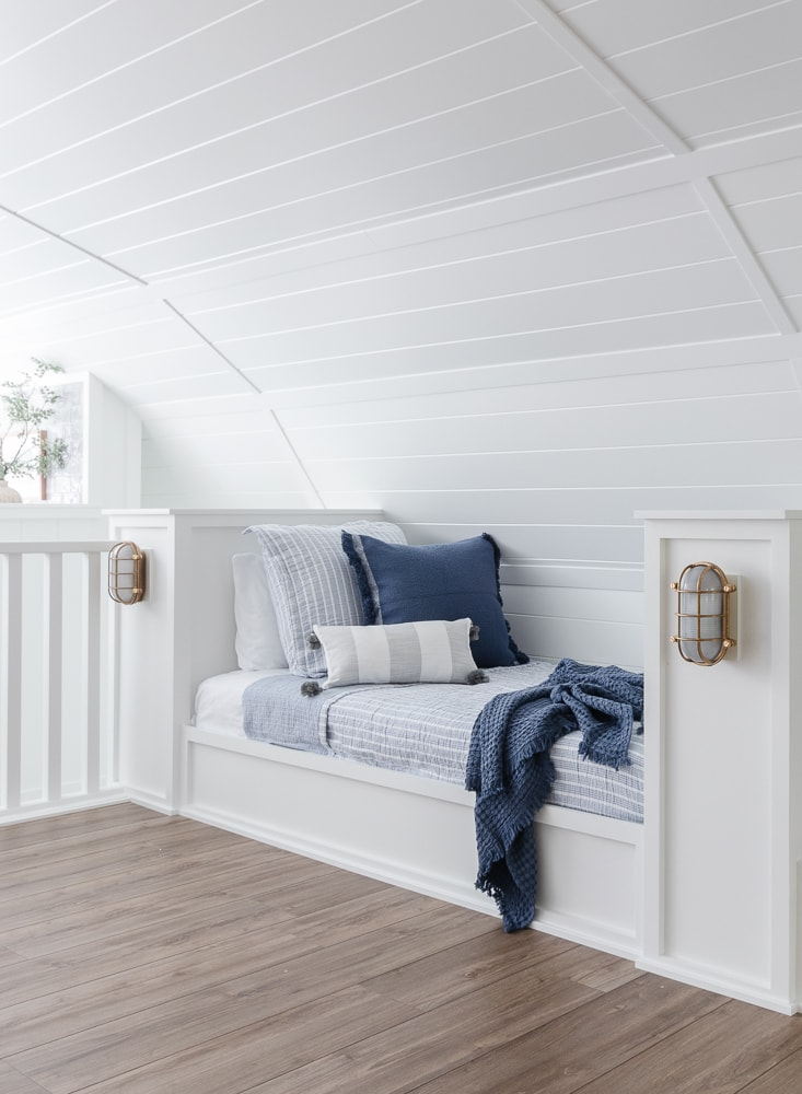 built in beds with white and blue bedding