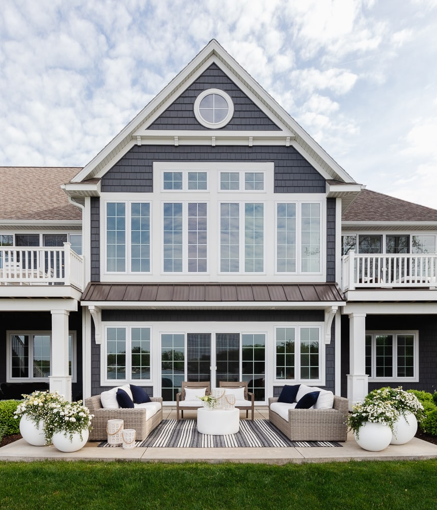 gray lake house patio with gray outdoor furniture