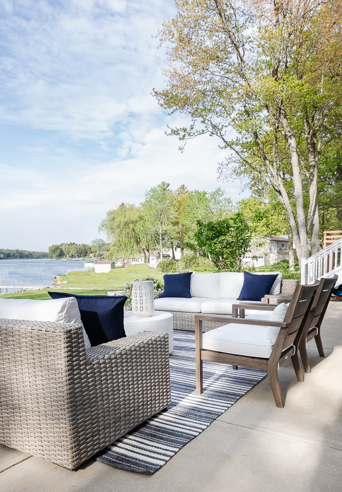 gray washed outdoor chairs with white cushions dark charcoal lake house striped rug