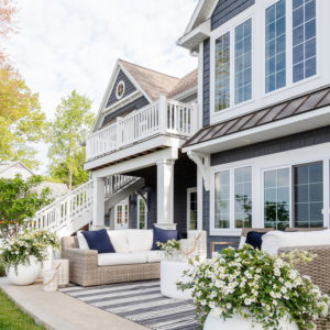 grey lake house with gray outdoor patio furniture
