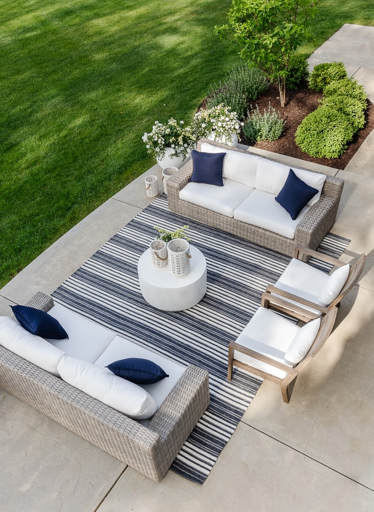 outdoor furniture striped rug gray sofas and cement looking table