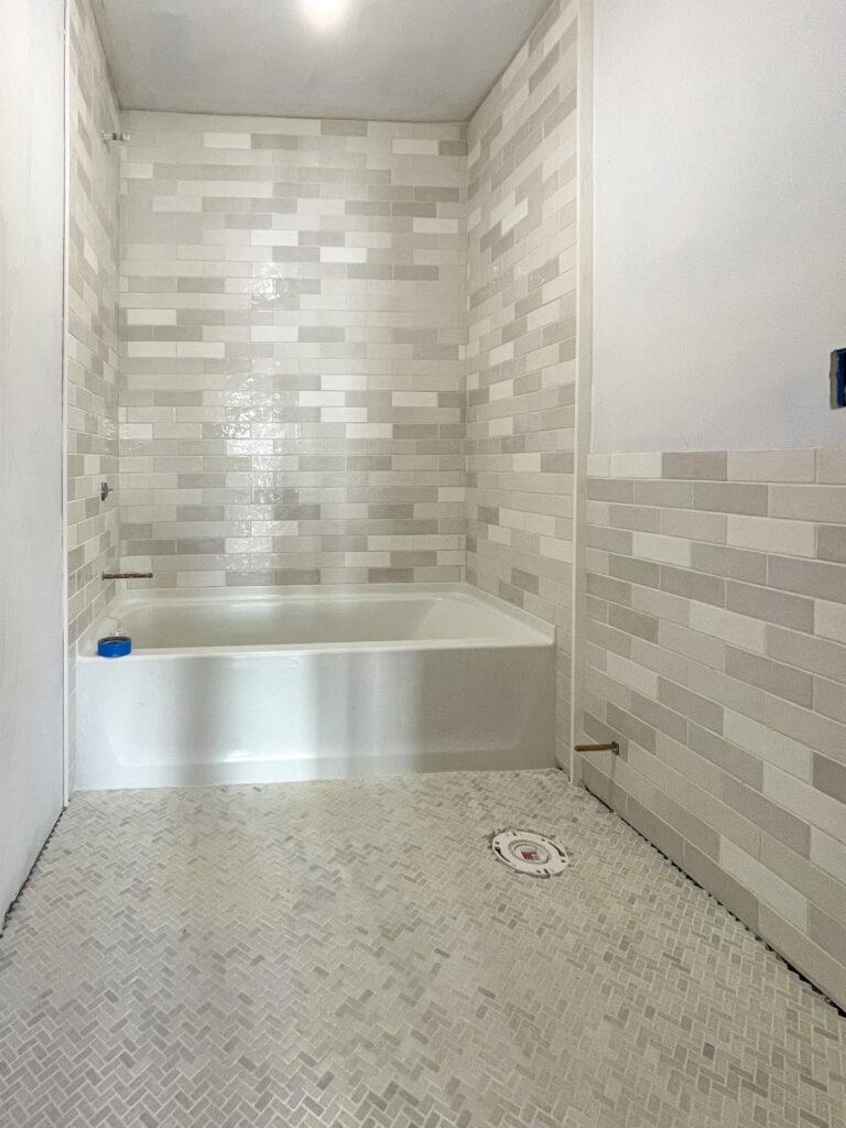 gray and white tile bathroom remodel progress
