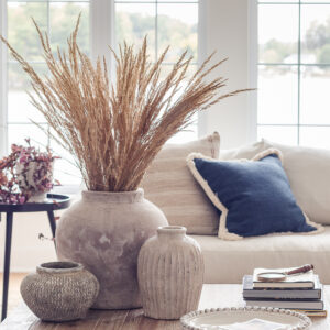 stoneware vases with beach grass and fall throw pillows